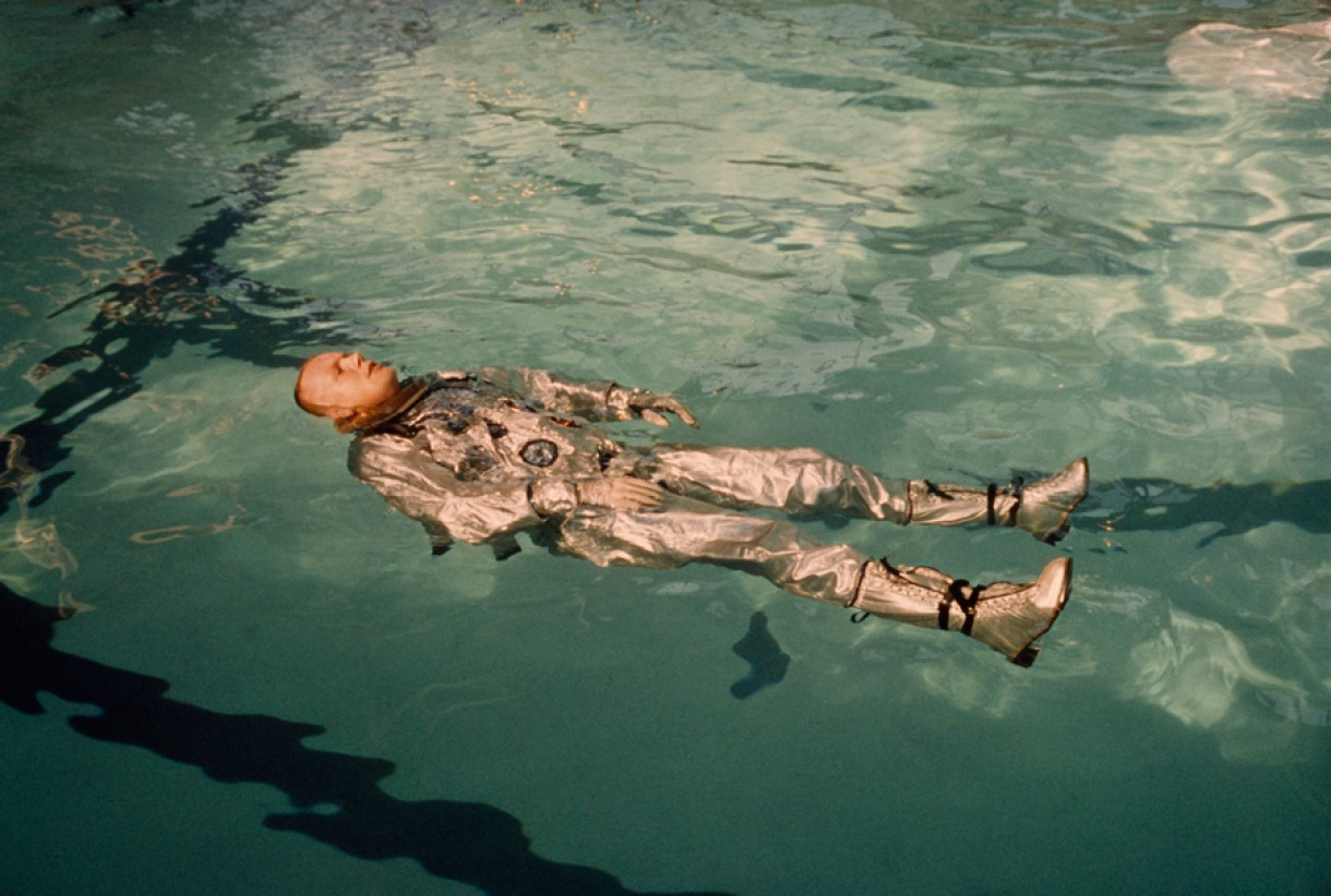 Astronaut Neil Armstrong floats in his space suit in a pool of water in 1967